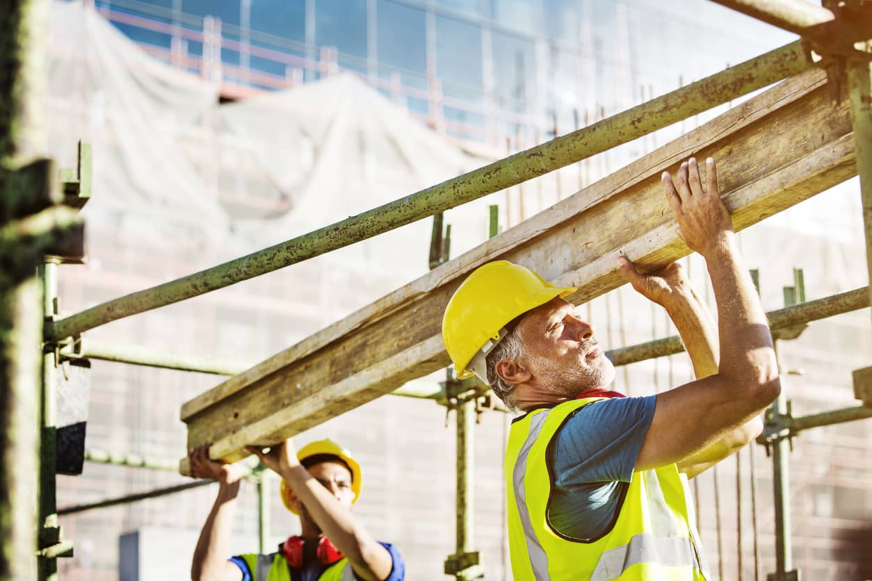 skilled tradesman and laborers on job site