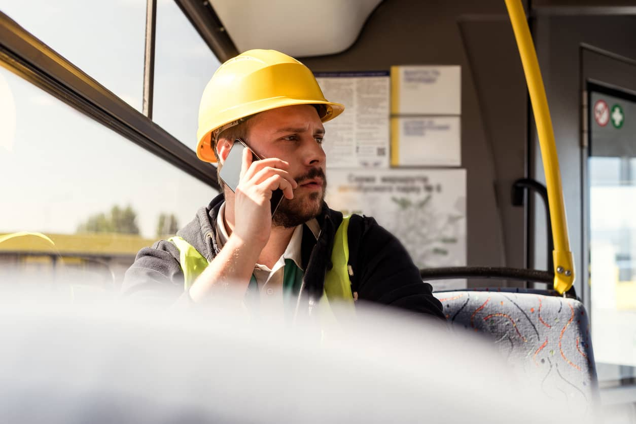 electrician getting call from employer