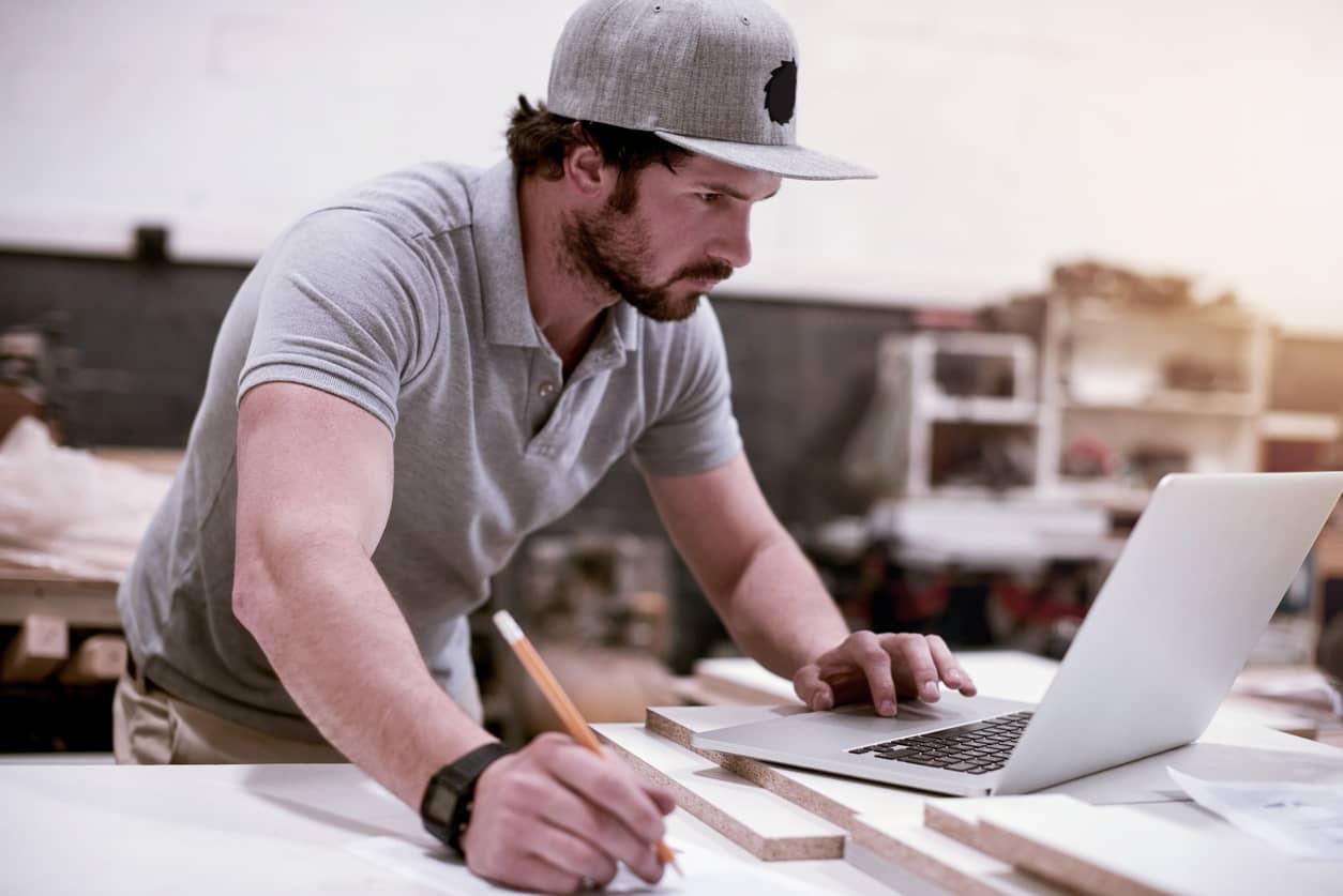 tradesman looking on construction job boards