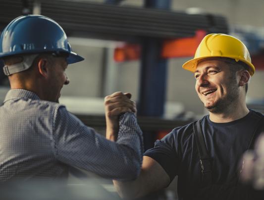 internal recruiter talking to skilled tradesman on job site